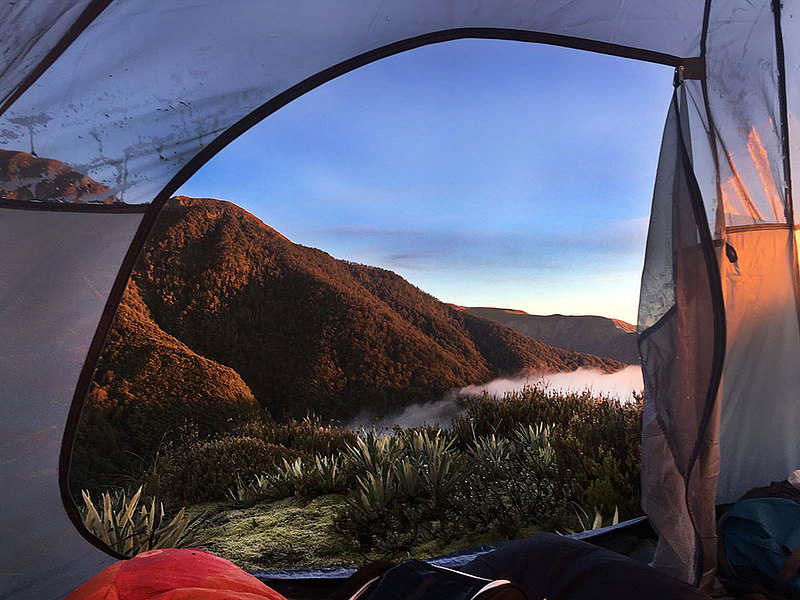 "While studying in New Zealand, Hailey Mohler '18 took the opportunity to backpack with friends. She writes: ""This picture was taken at about 6:30 a.m. when the sun woke my friends and me up in our tent somewhere near the base of Mount Somers. We'd hiked about halfway there the night before in the rain and fog with hopes to get to the top the next morning. Since it was so dark and foggy the night before, we had no idea what was around us when we got in our tent to sleep. Needless to say, we were not disappointed the next morning to wake up to this view."""