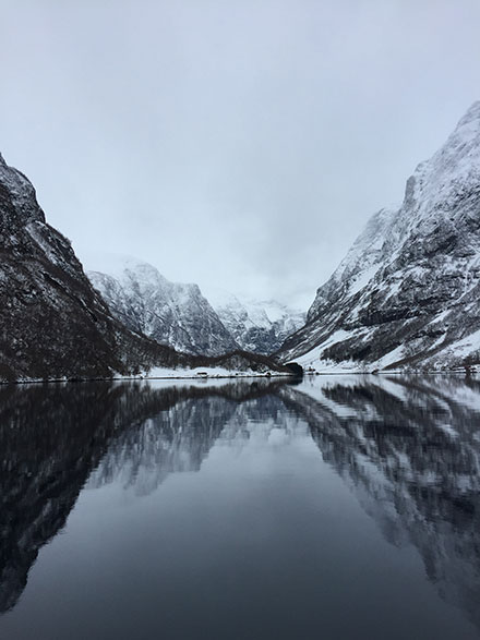 "Biology major Brendan Londergan '19 took this photo in Flåm, Norway, during an Exploring the Ethics of Sustainable Organizations trip to Norway and Sweden over J-term 2018. ""It was the true beauty of nature that inspired me,"" he says. ""The towering walls of the fjord instilled in me a sense of insignificance but also of protection as it made me feel like I was one with the earth."""