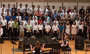 Luther Professor Jennaya Robison conducting the Dorian Middle School Summer Camp Choir at the Grand Concert June 16, 2018.