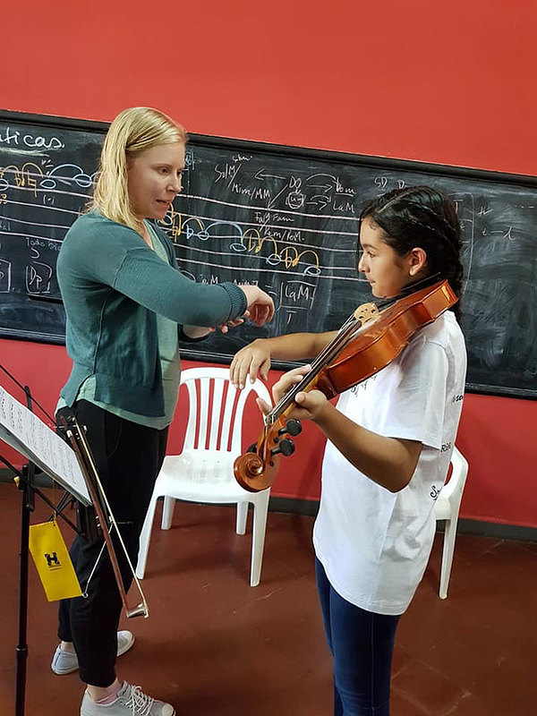 In March 2018, Kratchmer taught a master class to students in the Sonidos de la Tierra program in Encarnacion, Paraguay.