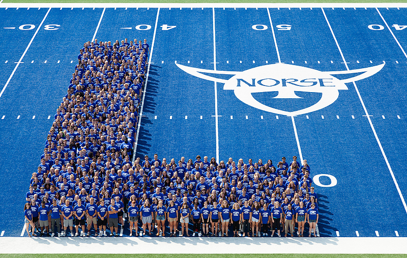 The Luther College Class of 2022, arranged for their class photo on the blue turf of Carlson Stadium. August 25, 2018. Photo by Nathan Riley.