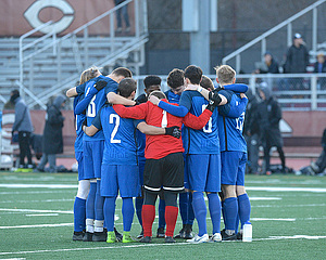 "Team Huddle - Photo by Jeff Nelson<a href=""/reason/images/840518_orig.jpg"" title=""High res"">∝</a>"