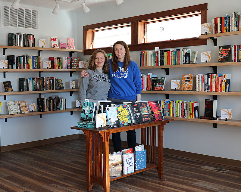 Katie Terhune '11 (left) and Kacey Wyttenhove '11 (right) met as Luther students and recently went into business together to cofound Cream & Amber, a bookstore in Hopkins, Minn., that also offers beer, coffee, and food.