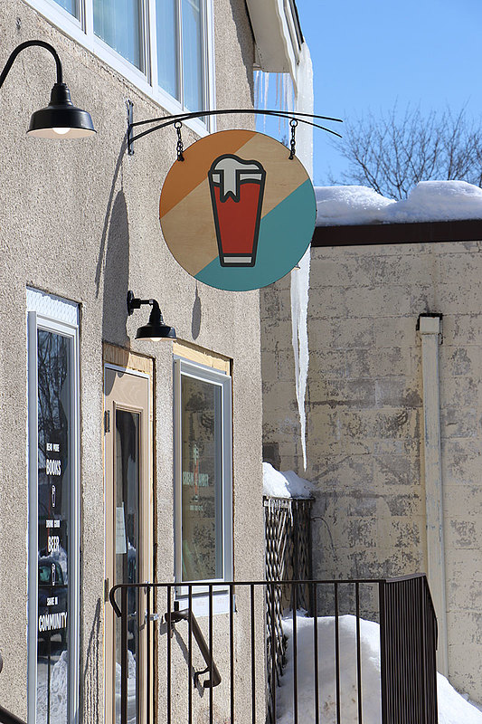 A bubbly pint greets visitors to Cream & Amber bookstore in Hopkins, Minn.