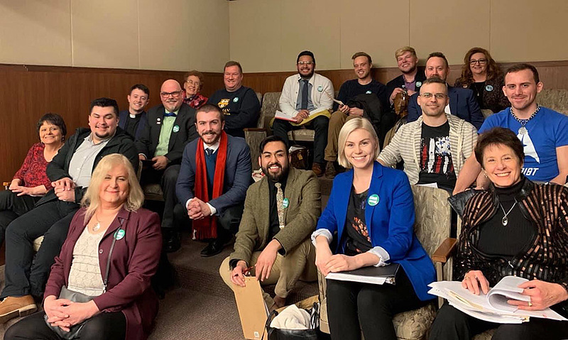 In his work as policy and organizing coordinator at OutFront Minnesota, Lucero (center) gathered with coworkers, testifiers, and elected officials at a hearing to ban conversion therapy in Minnesota at a Minnesota House of Representatives Health and Human Services Committee meeting.