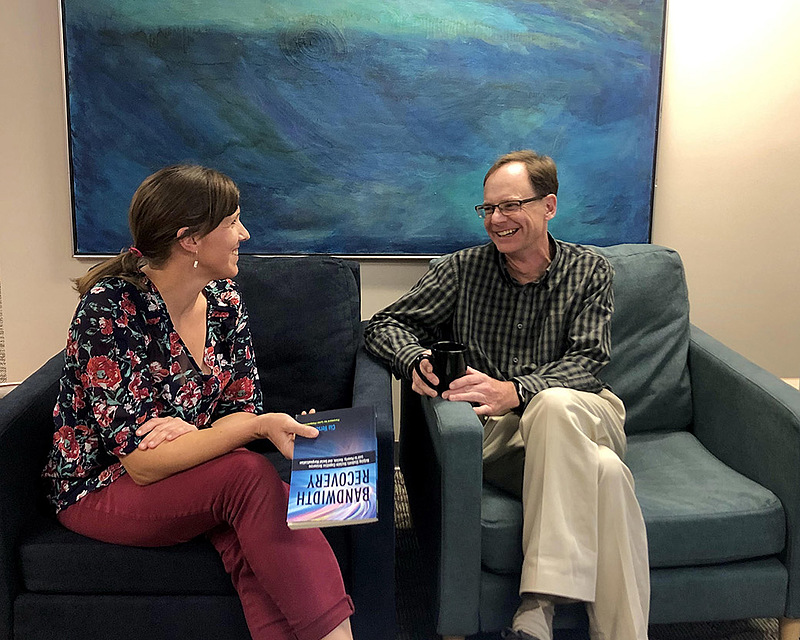CELT director Kate Elliott chatted last fall with associate dean and faculty member Jeff Wilkerson in the CELT office space, a new support center for faculty.