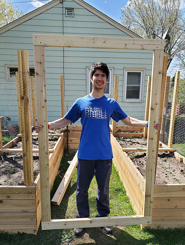 During the spring semester, Firdavs Atabaev '22 stayed with Phil '87 and Sarah (Henning) Iversen '87. He especially enjoyed doing home-maintenance projects, like building raised gardening beds, with Phil.