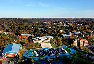 Aerial view of Luther College Campus and football field in autumn.