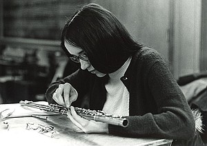 A student works on repairing a flute.