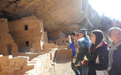 "Students check out the Pueblo ruins at ""Spruce House"" in Mesa Verde National Park"