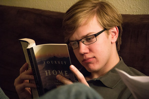 A Luther student reads a book for Philosophy.