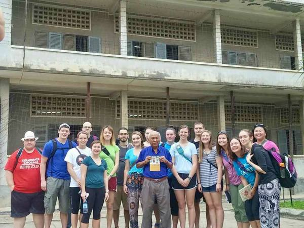 "Our group in front of one of the buildings of S-21 with a survivor of the genocide, Mr. Chum Mey<a href=""/reason/images/739014_orig.jpg"" title=""High res"">∝</a>"