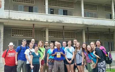 Our group in front of one of the buildings of S-21 with a survivor of the genocide, Mr. Chum Mey