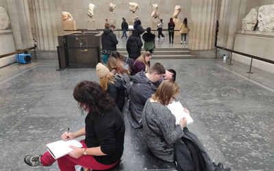 Students writing in their journals at the British Museum.