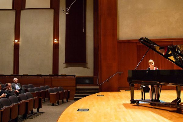 A student playing in piano seminar in the Noble Recital Hall.