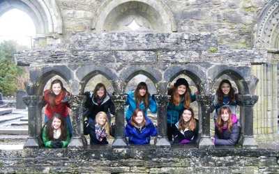 The group in the arches of a monastery in Cong