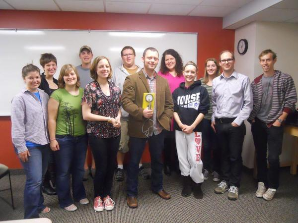 "Benjamin Percy (holding Geiger counter) visits Prof. Hageman's ""Technology and Ecology in Literature"" class, Spring 2012"