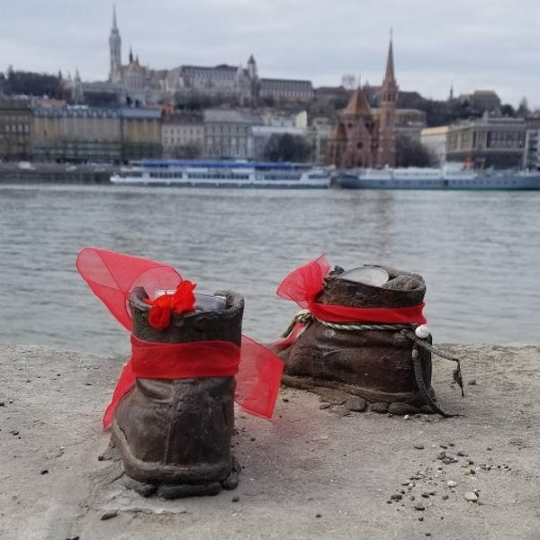 The shoes on the Danube River is a display to honor the people who were killed by fascist Arrow Cross militiamen in Budapest during World War II. They were ordered to take off their shoes and were shot at the edge of the water so that their bodies fell into the river and were carried away.
