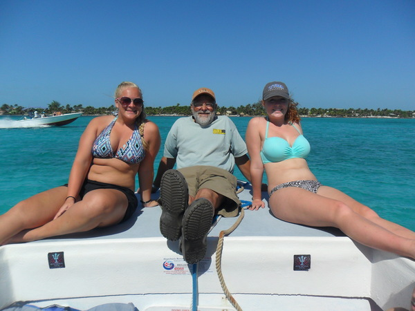 "Senior Brooke Stauffer, Jeff Boeke, and sophomore Amanda Nyquist soak up some sun during a fishing excursion.<a href=""/reason/images/743073_orig.jpg"" title=""High res"">∝</a>"