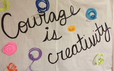 "The poster that read ""Courage is Creativity"" in Kennedy Middle School."