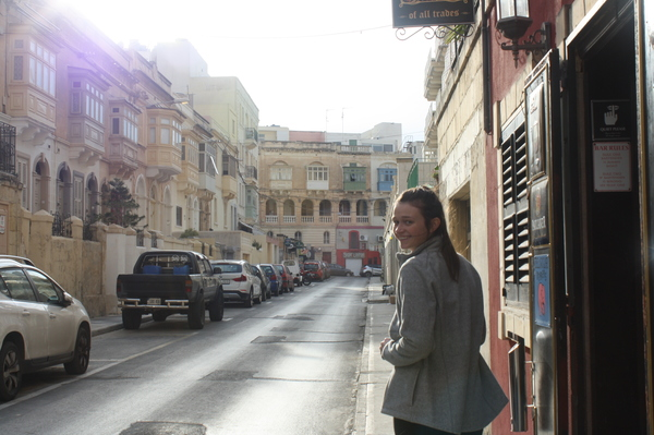 "Erin Hocker walking down a street in Sliema<a href=""/reason/images/802077_orig.jpg"" title=""High res"">∝</a>"