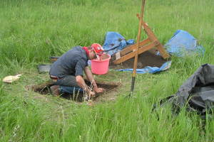 Anders Hopkins ('15) excavates a test unit on a prehistoric site during the summer archaeology field methods course.