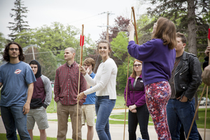 Students learn how to use an atlatl or spear thrower in the introductory Archaeology class.