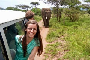 Rozyln Paradis '18 with an elephant while on a safari in Akagera National Park.