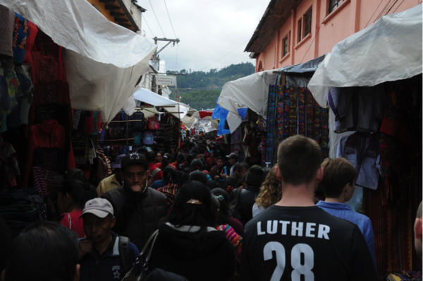 "Walking through the busy Sunday market in Chichicastenango.<a href=""/reason/images/740092_orig.png"" title=""High res"">∝</a>"