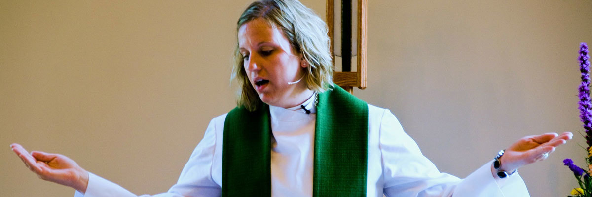 Rev. Joy Alsop '05 presides over communion at Christ Lutheran Church, Belvidere, IL.