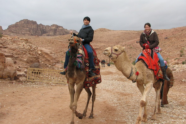 Students riding camels.