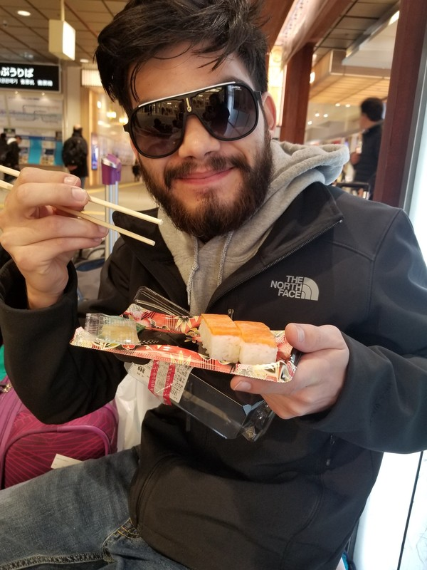 "Author Brady Pierce posing with sushi at one of our many train station stops.<a href=""/reason/images/800103_orig.jpg"" title=""High res"">∝</a>"