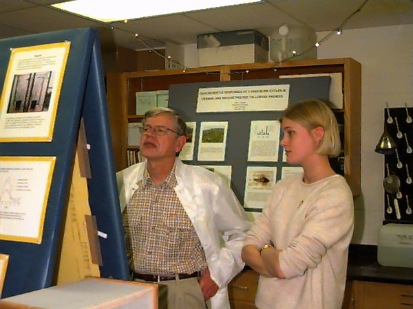 Russ discusses student research project during poster session with Katie Marske