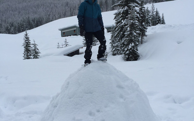 Testing the structural stability of the igloo Abby, Eliza, Kristina, and I built by standing on top of it.