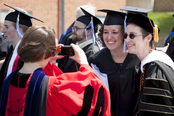 A Luther student posing with Professor Elizabeth Steding at Commencement.