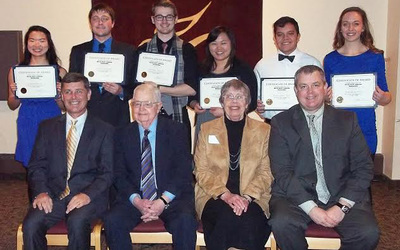Luther College students (back row, left to right): Samantha Ea, Fred Scaife, Chris Wieseler, MaiTeng Moua, Pedro Lopez Vega, and Makeda Barkley celebrate with members of the Anderson family, who established the Steven Mark Anderson Scholarship at Luther College and presented the awards during the 2015 Student Support Services Celebration Banquet. Anderson family members present were (front row, left to right): Scott Anderson, Lloyd and Kathy Anderson, and Stuart Anderson.