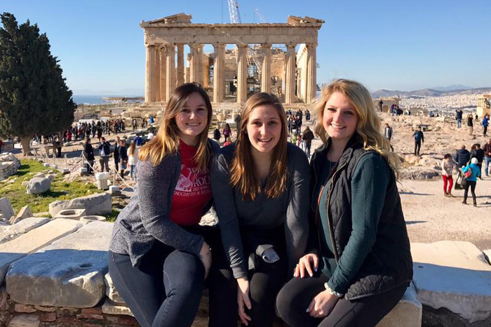 Students posing for a group picture while studying abroad.