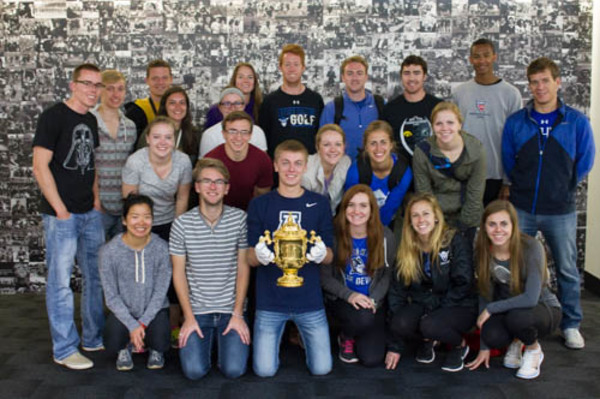 The group holding the Rugby World Cup.