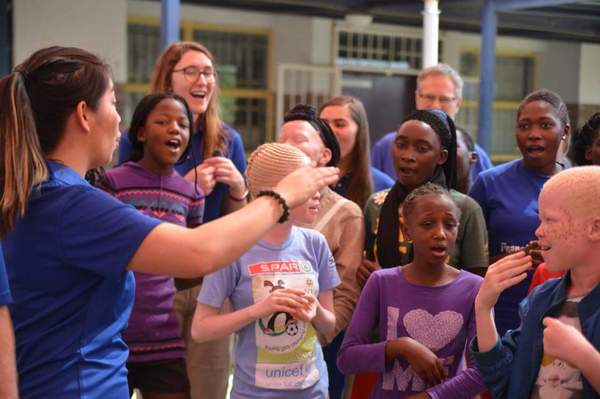 "Amy conducting happy singers<a href=""/reason/images/799155_orig.jpg"" title=""High res"">∝</a>"