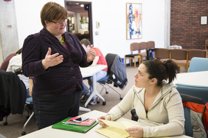 Professor Lauren Anderson discussing a classroom project with a student.