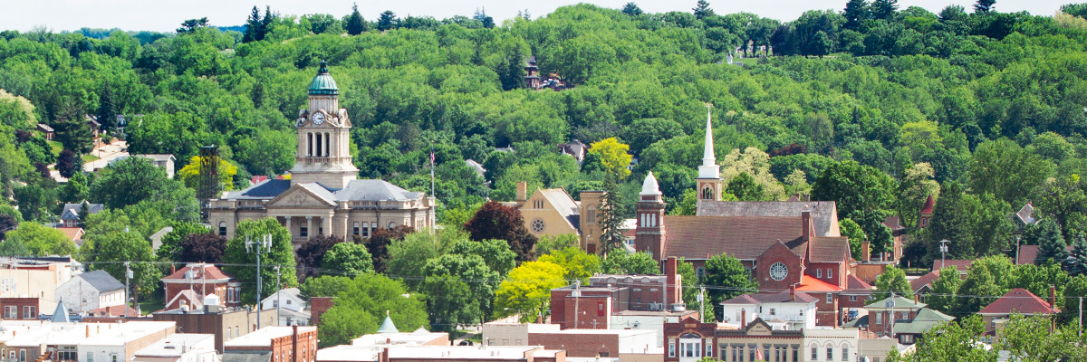 A view of Decorah, including courthouse and local churches.