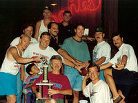 1994 Draft at Dante's in Decorah. (Front row) Dave Kust '80, Mike Kust '78, Andy Kust '10, Walt Will, Kirk Neubauer '76. (Middle row) Greg Carrier '79, Daryl Walsh, Scott Ellingson '84, John Balk '83, Randy Balk '79. (Top row) Jeep Kust '84, Keith Ellingson '79.