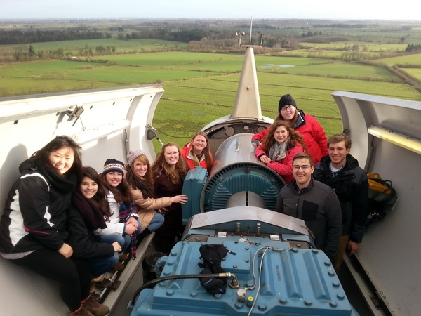 This is a picture with half of the group at the top of the wind turbine!