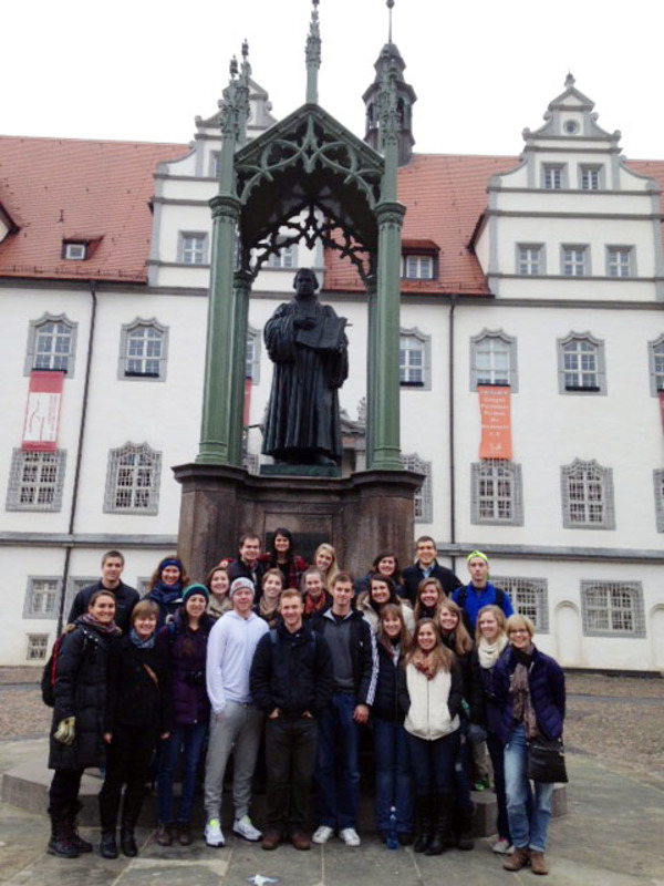 Students in front of Martin Luther Statue in Wittenberg, Germany as part of REL 239 J-term 2015.