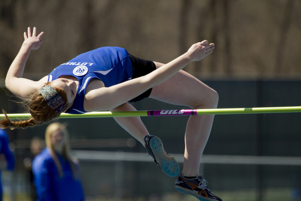 Luther track member making it over the high jump.