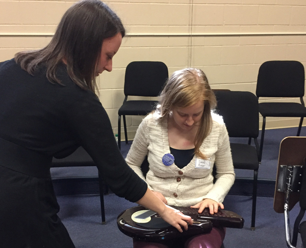 "Andrea Halvorson '10 lets students try some of the instruments she uses in her work as a music therapist.<a href=""/reason/images/770240_orig.jpg"" title=""High res"">∝</a>"