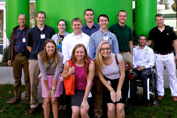 "Luther students and their professor pose in front of the ""Android"" at the Google campus."