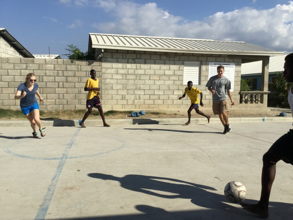 "Lauren and Kyle facing off with Haitian youth.<a href=""/reason/images/668308_orig.jpg"" title=""High res"">∝</a>"