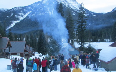 Holden Village's Epiphany service, where the community gathers for tree burning and communion.