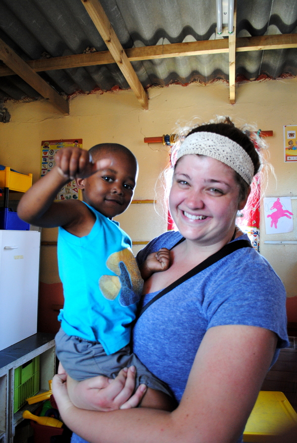 "Caitlin Olson bonds with a young boy at Ubuntu Rescue a child at Risk Center.<a href=""/reason/images/526322_orig.jpg"" title=""High res"">&prop;</a>"